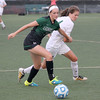 Zionsville's Caroline Caldwell fends off a Westfield player on Wednesday.