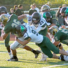 Zionsville's David Gruniger tackles a Westfield player on Friday night.