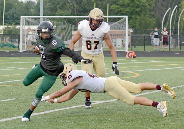 Tommy Fossett eludes a Brebeuf defender Friday.