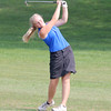 Western Boone's Lily Williamson follows through with an approach shot on Saturday at the golf regional.