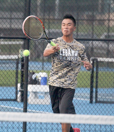 Tiger senior Jacob Copeland hits a forehand in his match at No. 2 singles on Thursday. Copeland was one of four seniors honored for senior night.