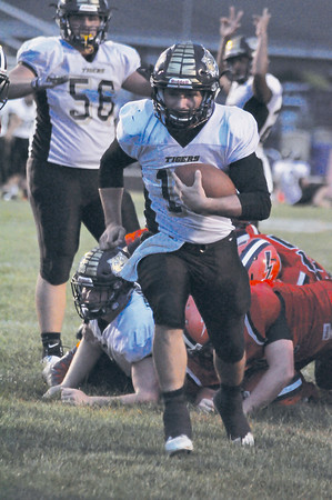 Lebanon quarterback Evan Stambaugh runs for a touchdown in the second quarter on Friday night.