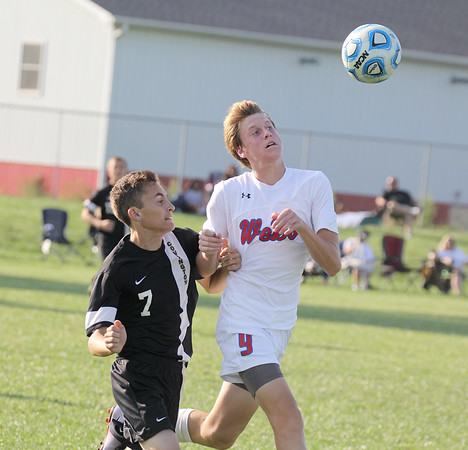 Western Boone's Keller Wilkinson goes after a 50-50 ball on Thursday.