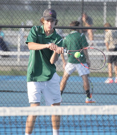 Mark Huibregtse hits a backhand in the match at No. 1 doubles on Thursday evening.