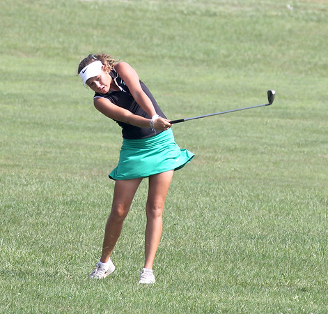 Zionsville freshman Abby Thielbar follows through with a shot on Saturday at the Roncalli Regional. Thielbar shot an 82 to help the Eagles earn a berth in the state finals.