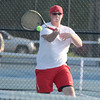 Photo by Will Willems | The Lebanon Reporter<br /> Western Boone's John Bromberek hits a forehand in the match at No. 2 doubles on Thursday.