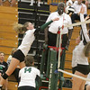 Erin Uebele goes up for a kill against Westfield on Thursday.