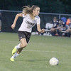 Madison Maher dribbles up the field in the second half on Wednesday.