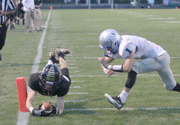 Zack Dafoe dives for a touchdown in the first half on Friday night.