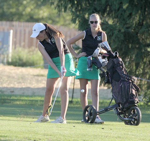 Zionsville's Claire Drew hits an approach shot on the 18th hole on Monday.