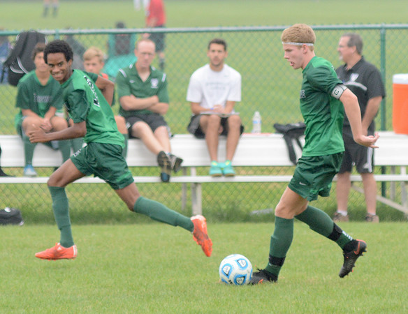 Zionsville's Sam Schmidt controls the ball as Nico Barrett makes a run.
