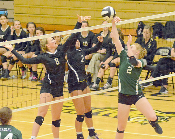 Lebanon's Tori Harker and Kassidi Cadle battle with Zionsville's Mamie Garard at the net.