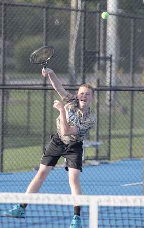 Lebanon's Sam Hood serves in the match at No. 1 doubles on Thursday in the sectional semifinal.
