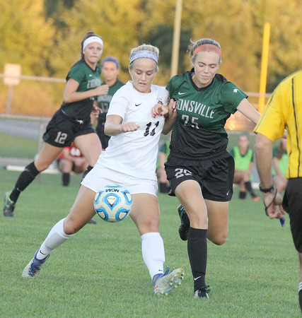 Photo by Will Willems | Times Sentinel<br /> <br /> Zionsville's Erin Patterson tries to get the ball from Avon's Hope Van Wagner on Monday, Sept. 19.