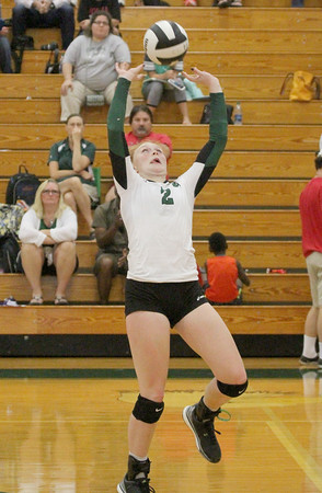 Mamie Garard sets a teammate in the fifth set on Thursday. Garard had 60 assists in the match.