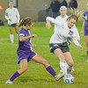 Photo by Debbie Beigh | For the Times Sentinel<br /> <br /> Zionsville's Chloe Jenkins gets the ball away from a Brownsburg player in the first half on Wednesday night.