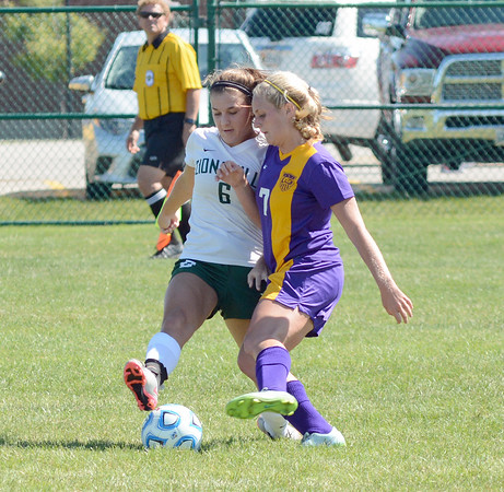 Megan Tanona takes the ball away from Marion's Sophia Kitts in the Lady Eagles win at the Zionsville Invite.