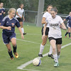 Photo by Will Willems | The Lebanon Reporter<br /> <br /> <br /> Lebanon's Amber Brummett works to clear the ball away from a North Montgomery player on Wednesday.