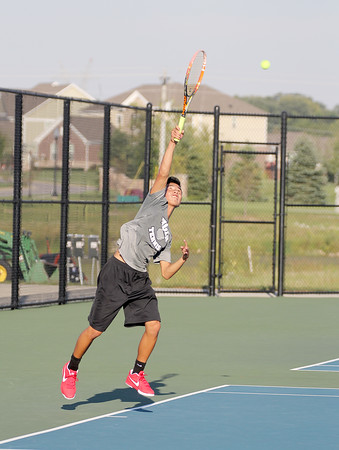 Lebanon's No. 2 singles player Jacob Copeland serves in his match against Zionsville.