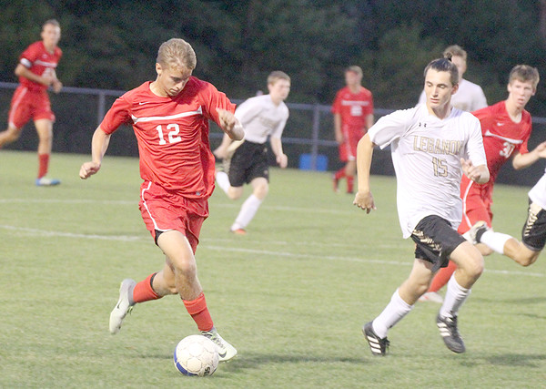 Western Boone's Miles Clutter brings the ball up field as Lebanon's Brandon Morgan defends in the second half.