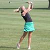 The Eagles' Maggie Nobbe watches her approach shot on the 18th hole on Saturday at the regional.