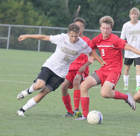 Lebanon's Parker Newman dribbles past Western Boone's Keller Wilkinson in the first half on Thursday.