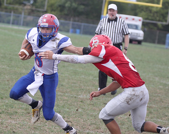 Western Boone's Jack Gilliam stiff arms a Southmont defender on his way to a 10-yard touchdown on Saturday.