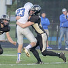 Evan Jones tackles Frankfort's Kahner Huffer on Friday night in the Tigers' blowout win.