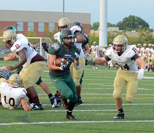 Nick Brier runs through a big hole on Friday against the Braves.