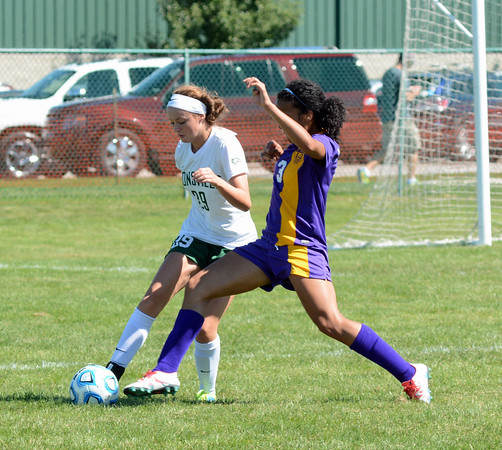 Caroline Caldwell clears the ball away from Marion's Jaeda Manuel on Saturday, Sept. 3.