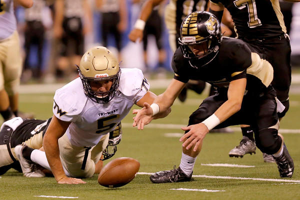Tri-West High School tight end Peyton Hendershot  (5) and Lebanon's Nick Bland go after a loose ball during the game between Tri-West vs Lebanon at Lucas Oil Stadium in Indianapolis,IN. (Jeff Brown/Flyer Photo)