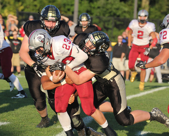 Danville's Bryce King fights for extra yardage against Lebanon on Friday night.