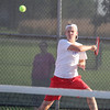 Korbin Lough follows through on a forehand at his match at No. 1 singles on Tuesday.