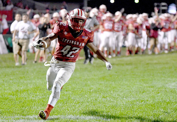 Effingham's Terrence Hill scores on a 40-yard run against Charleston at Klosterman Field.<br /> Chet Piotrowski Jr./Piotrowski Studios
