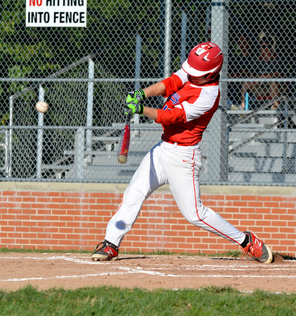 St. Anthony's Brandon Puckett connects on a two-run double during a 13-0 win over Neoga. Puckett also threw a shutout on the mound.