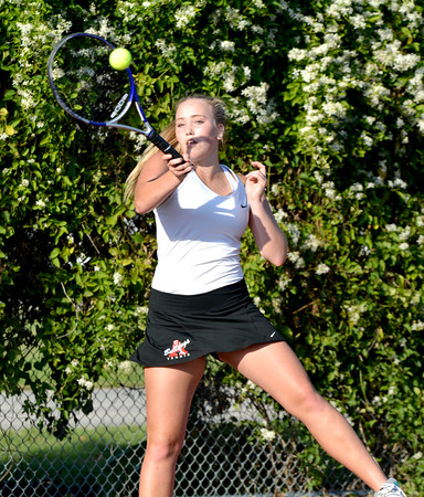 St. Anthony's Kelly Rentfrow returns with a forehand during a doubles match against Effingham.