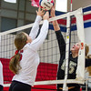 St. Anthony's Jenna Woltman (left) jousts with Altamont's Taylor Paquette (15).