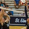 Teutopolis' Savannah Grimes (right) lands a hit while St. Elmo/Brownstown's Brandi Howard and Madison Carson try to block.