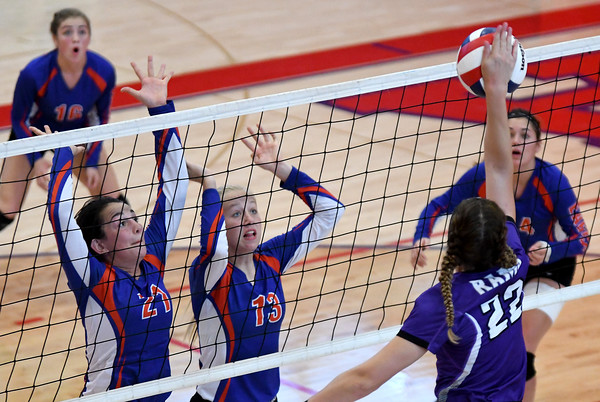 Newton's Abby Frohning (21) and Ali Bierman (13) prepare to block a spike from Shelbyville's Maddie Holland during the three-set championship match win by Shelbyville at the 2016 St. Anthony Volleyball Invitational.<br /> Chet Piotrowski Jr./Piotrowski Studios