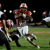 Effingham's Terrence Hill attempts to elude Highland's Brayton Moss during the weather delayed first half at Klosterman Field.<br /> Chet Piotrowski Jr./Piotrowski Studios