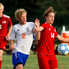 Newton's Greg Shinn (2) is shielded away from the ball by St. Anthony's Jacob Zimmerman (14) as teammate Jack Nuxoll catches up from behind.