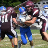 Newton's Nate Meinhart tackles Robinson's Dylan Dirks.