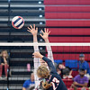 St. Anthony's Meg Richards blocks a spike by Pana's Jenna Dudra during their crossover match at the 2016 St. Anthony Volleyball Invitational.<br /> Chet Piotrowski Jr./Piotrowski Studios