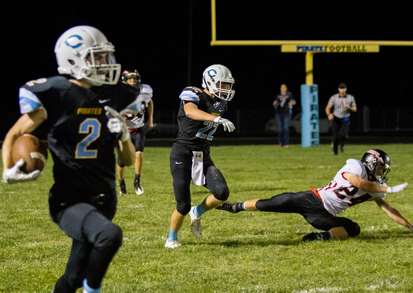 Sullivan-Okaw Valley's Queinton Britton is sent to the ground by Cumberland's Tannery Kingery after Myles Gerhardt (left) intercepted his third pass of the night. Despite the sophomore's efforts, Cumberland fell 46-30.