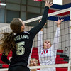 St. Anthony's Katie Kabbes (10) goes up for a block on Altamont's Leah Mayhaus (5), while teammate Marci Mills watches from the middle.