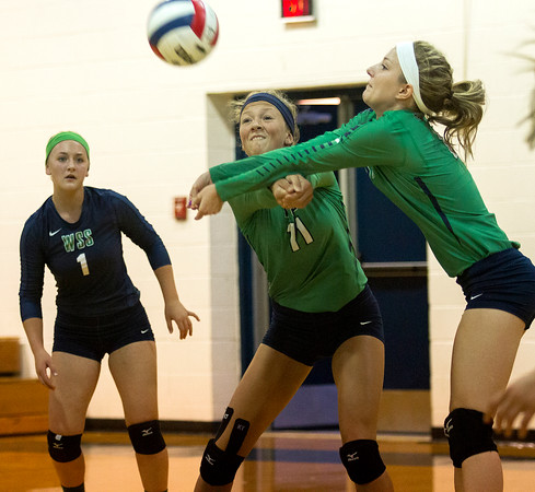 Windsor/Stew-Stras' Mikayla Haddock (right) receives the hit from Cumberland just ahead of teammate Megan Schlechte (middle), while libero Carson Cole looks on from the left.