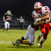 Effingham's Terrence Hill runs through a tackle by Salem's Levi Davis.