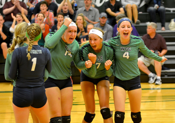 Windsor/Stew-Stras' Calla Roney (14, left), Becca Schlechte (7, center) and Mikayla Haddock (4, right) celebrate the final point of the Hatchets' win over Shelbyville.
