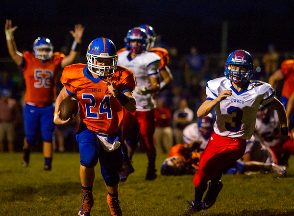 Newton's Mitch Bierman (24) rushes towards the end zone during the first half, while Red Hill's Chase Murray tries to catch the running back. Bierman scored four touchdowns in the Eagles' 49-14 win.