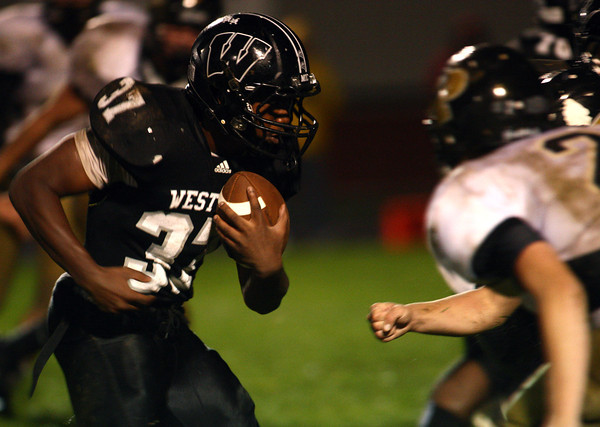 9-21-12<br /> Western HS football vs Peru<br /> Western's James Davis looks to break through Peru's defense during the football game Friday night.<br /> KT photo | Kelly Lafferty